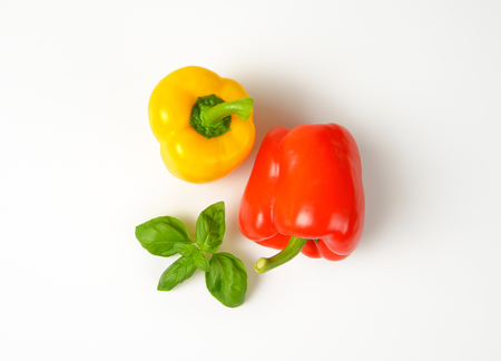 yellow and red bell peppers on white background