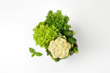green vegetable: lettuce, cauliflower and courgettes in a basket Stock Photo