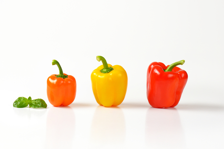 bell peppers: three ripe bell peppers on white background Stock Photo