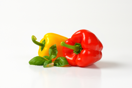 bell peppers: yellow and red bell peppers on white background