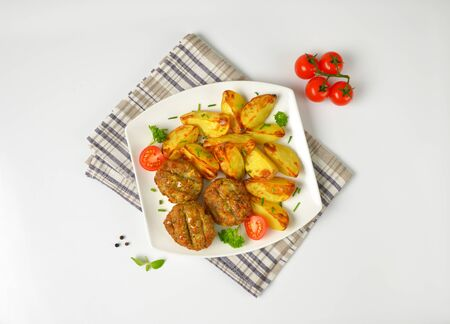 dish of vegetable and cheese patties with potato wedges
