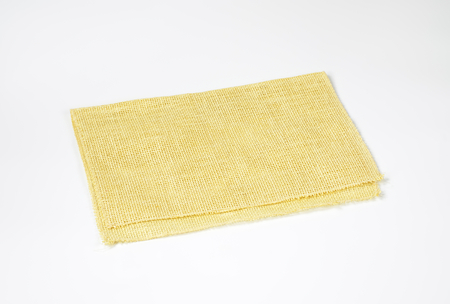 placemat: straw woven placemat folded once Stock Photo