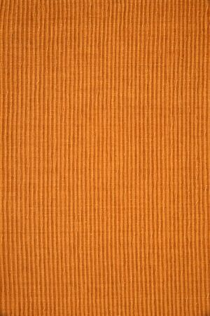 placemat: Detail of brown woven ribbed cotton placemat