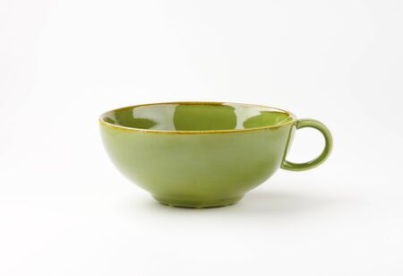 circle objects: empty green soup bowl with one handle on white background