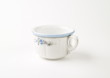 antique dishes: hand painted rustic tea cup on white background Stock Photo