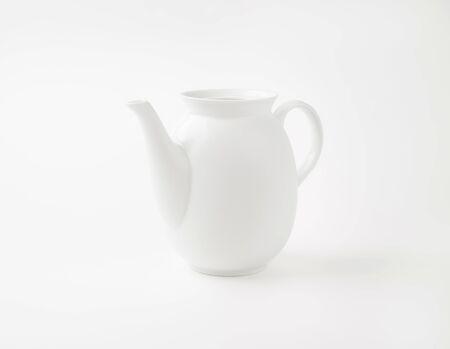 the milk jug: empty white porcelain milk jug