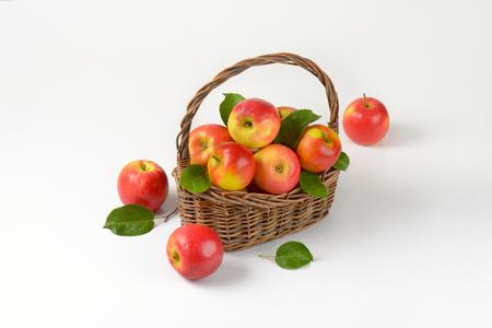 basketful: fresh red apples in a wicker basket Stock Photo