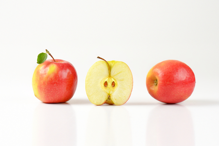 halved  half: two and a half apples on white background
