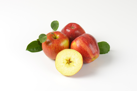 halved  half: three red apples and half with a star-shaped core