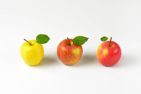 white washed: three washed apples in a row on white background