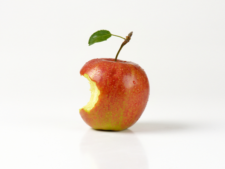are taken: Red apple with a bite taken on white background Stock Photo