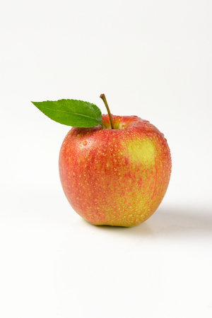 apple red: washed red apple on white background Stock Photo