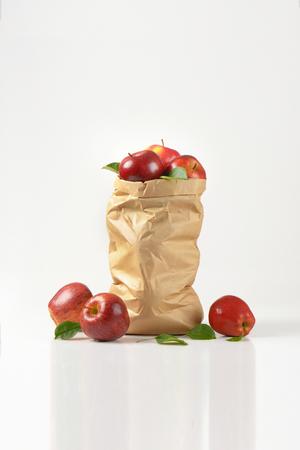 apple paper bag: paper bag of ripe apples on white background