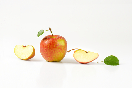quarters: two apple quarters next to a whole apple Stock Photo