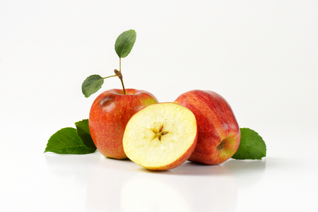 halved  half: two red apples and half with a star-shaped core