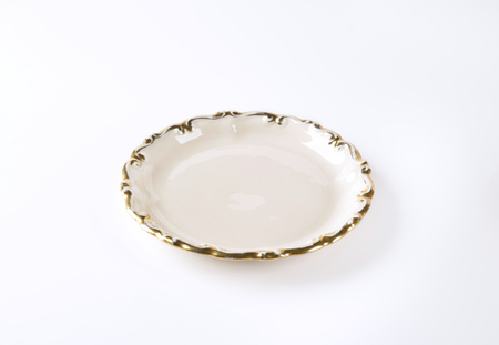 antique dishes: white plate with gold decorative edge Stock Photo