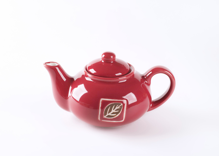 red tea: red tea pot on white background