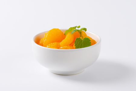 segments: bowl of peeled tangerine segments Stock Photo