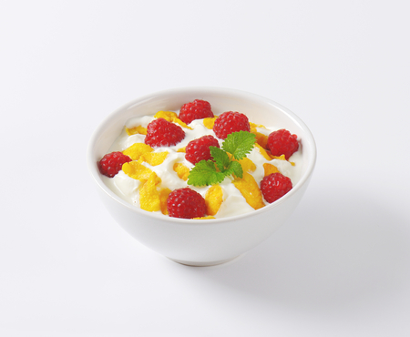 cornflakes: healthy breakfast - bowl of yoghurt with raspberries  and cornflakes