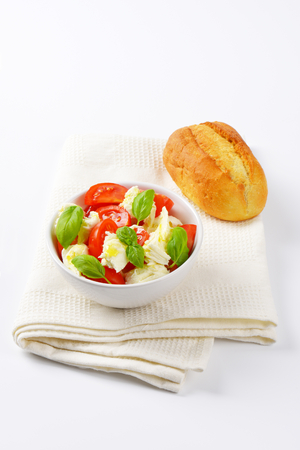 caprese: bowl of caprese salad and fresh bun