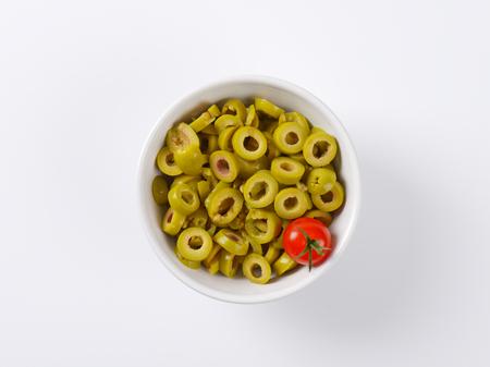 green olives: bowl of sliced green olives Stock Photo