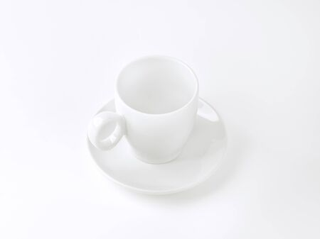 saucer: tall porcelain cup and saucer