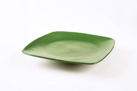 rimless: square green dinner plate for daily use Stock Photo