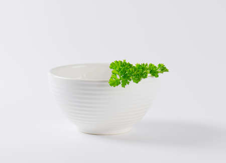 sprig: sprig of fresh parsley in white bowl