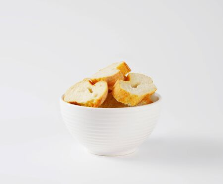 crusty french bread: sliced French bread in white bowl