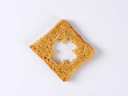 leaved: Slice of bread with cut out four leaved clover shape