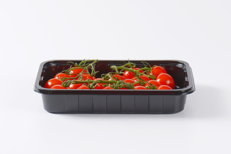 plastic container: fresh cherry tomatoes in black plastic container
