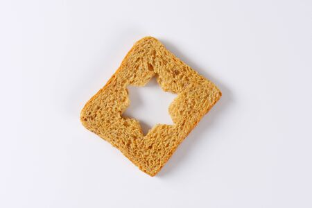 to cut out: Slice of bread with cut out star shape