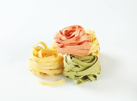 ribbon pasta: Bundles of dried ribbon pasta