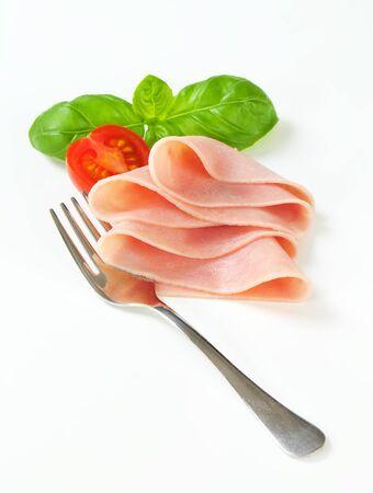 halved  half: Studio shot of thinly sliced ham