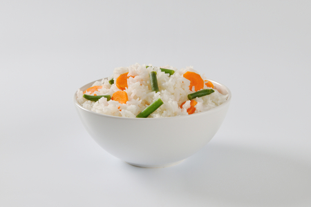 jasmine rice: Bowl of Jasmine rice with carrot and string beans