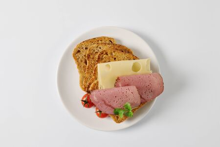 whole grain: toasted slices of whole grain bread with cheese and ham
