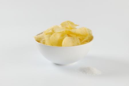 nibbles: Bowl of thin potato crisps Stock Photo