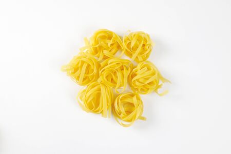 coiled: Dried ribbons of pasta coiled into nests