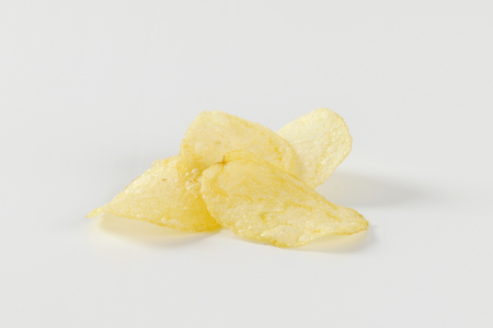 crisps: Heap of salted thin potato crisps