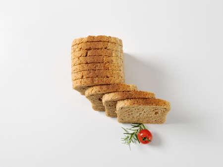 whole wheat toast: sliced loaf of whole grain bread Stock Photo