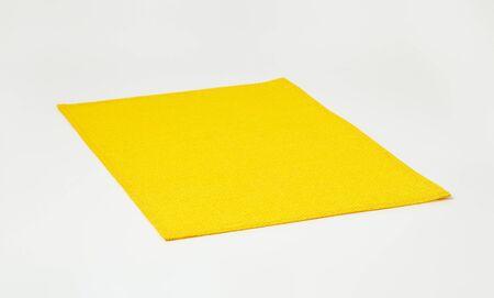 rectangular: Waterproof basketweave rectangular yellow place mat Stock Photo