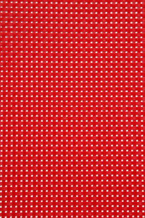 placemat: Detail of red plastic placemat Stock Photo