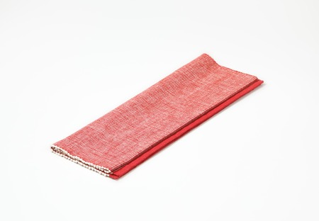 place mat: Folded red cloth place mat