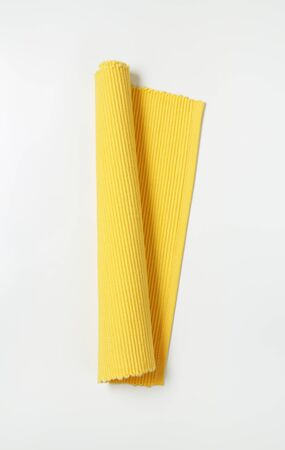 placemat: yellow ribbed cotton placemat, rolled up