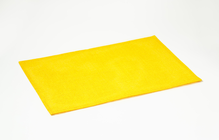 waterproof: Waterproof basketweave rectangular yellow place mat Stock Photo