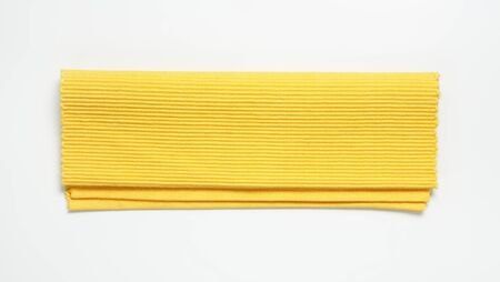 ribbed: Folded yellow ribbed cotton placemat