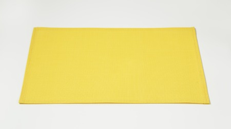 rectangular: basketweave rectangular yellow place mat Stock Photo