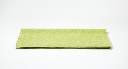 place mat: Light green place mat folded in half