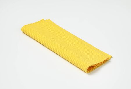 placemat: Folded yellow ribbed cotton placemat