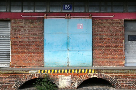 loading dock: Exterior of old brick warehouse with loading dock Stock Photo